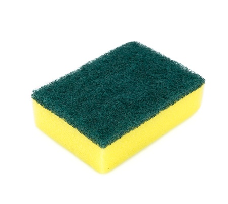 Kitchen sponge isolated on the white background photo