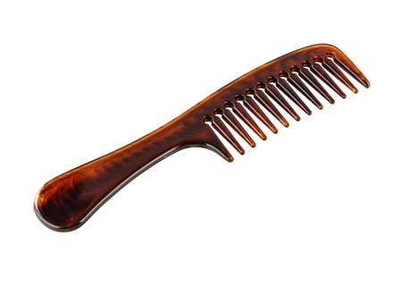 Brown plastic comb isolated on white background photo