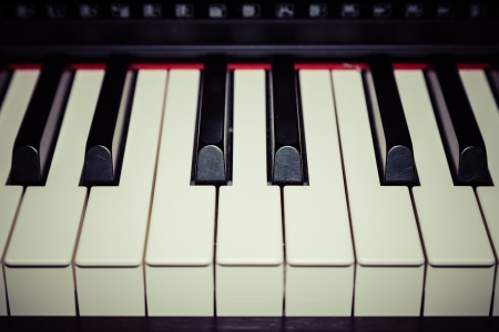 Close up of piano key, front view  vintage style effect