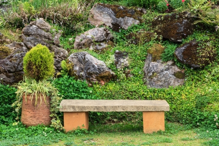 A stone chair in the park, front view