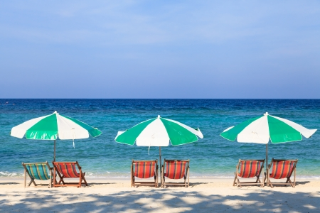 Colorful beach chairs and umbrellas on the beach Stock Photo