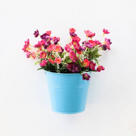 Colorful flowerpot on the white concrete wall Stock Photo - 18781720