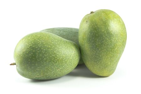 green mango: Three green mangoes isolated on white background