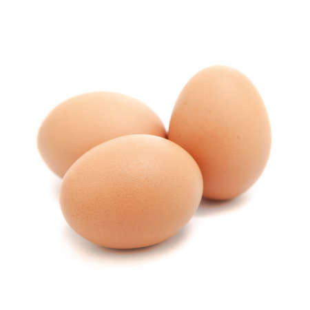 Three eggs isolated over the white background photo