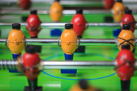 ARCADE GAMES: Closeup of colorful wood players of a table football toy Stock Photo