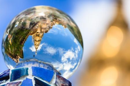 crystal bowl: Gold temple reflecting in crystal ball, Phetchabun, Thailand