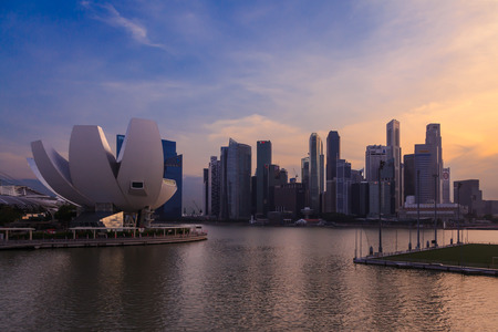 SINGAPORE CITY, SINGAPORE - AUGUST 16, 2015: Cityscape of financial district at Marina Bay and lotus-inspired ArtScience Museum during twilight on August 16, 2015 at Marina Bay, Singapore.