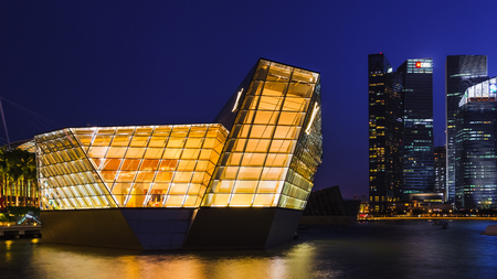 marina bay: MARINA BAY, SINGAPORE - AUGUST 16, 2015: Loius Vuitton store and financial district during twilight on August 16, 2015 at Marina Bay, Singapore.