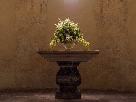 church flower: Decorated flower vase place on the altar in Swiss church. Stock Photo
