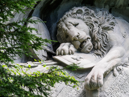 national monuments: Lewendenkmal, the lion monument landmark in Lucerne, Switzerland. It was carved on the cliff to honor the Swiss Guards of Louis XVI of France.