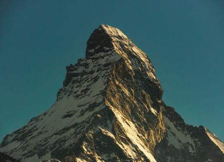 Matterhorn peak during sunset, retro style and grainy, view from gornergrat train station, Zermatt, Switzerland.