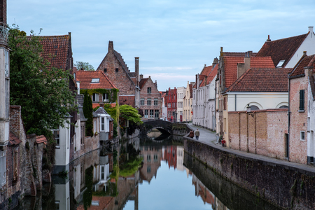 Beautiful old town and canal of Bruges with water reflection, Bruges, Belgium. Stock Photo