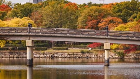 Famous tourist attraction, Gokurakubashi bridge at Osaka castle garden in autumn. Stock Photo