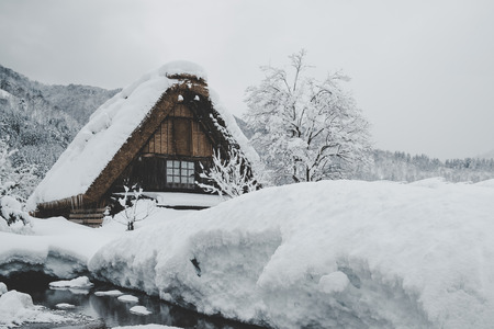 Historic Villages of Shirakawa-go, Japan in snowy day, film tone, classic look. Editorial