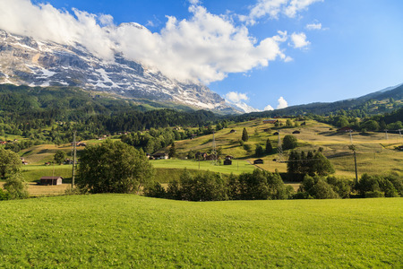 Beautiful summer view of mountain and small village. Beautiful outdoor natural scene in Swiss Alps, Switzerland, Europe.