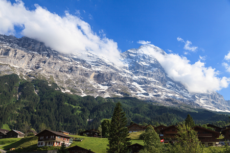 Beautiful summer view of mountain and small village. Beautiful outdoor natural scene in Swiss Alps, Switzerland, Europe. Stock Photo - 95075698