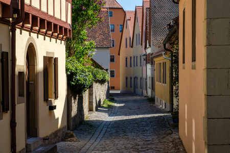 Colorful building in old alley of Rothenburg ob der Tauber city, Bavaria, Germany.