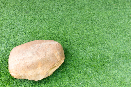river rock: stone on grass green background