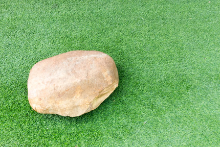 stone on grass green background