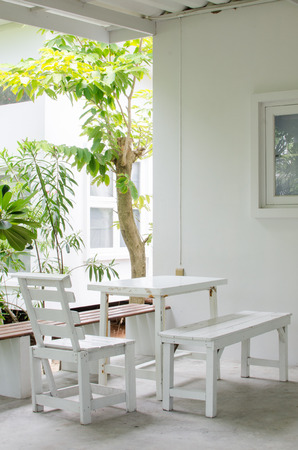 White chair and table in the garden photo