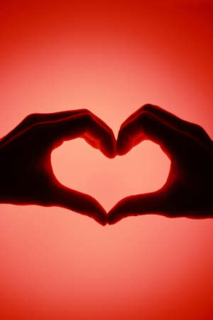 Heart shape with red background photo