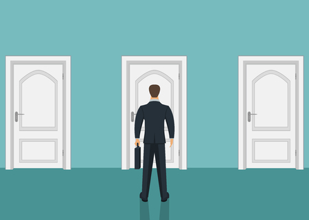 Businessman standing in front of door. Choosing the way. Moving forward
