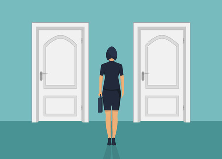 Businesswoman standing in front of the door. Choosing the way. Moving forward