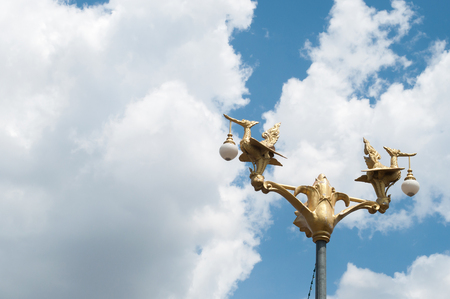 Thai style golden lamp statue and sky photo