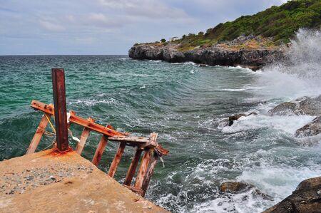 cruel: Rocky sea coast cruel wave