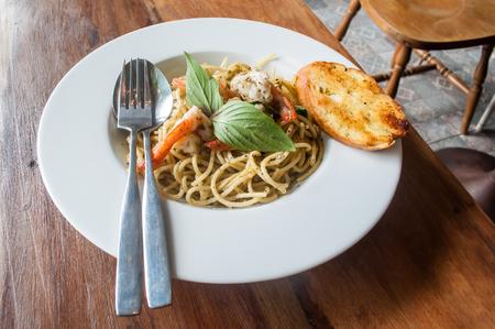 Spicy Spaghetti with Shrimp, Italian and Thai Cuisine Fusion Food Stock Photo