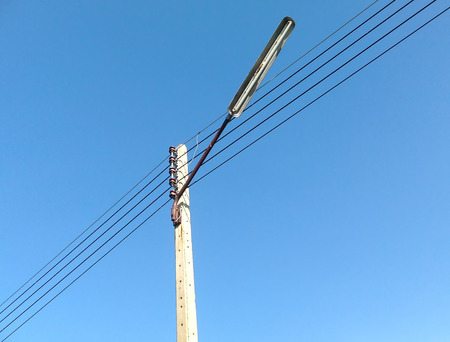 decrepitude: Electricity poles and lamp at the blue sky. Stock Photo