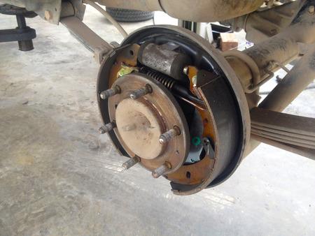 Drum brakes and wheel and suspension details. 版權商用圖片