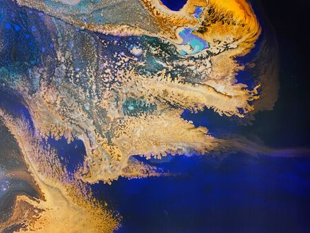 Abstract images from acrylic paint splashed onto canvas background images.