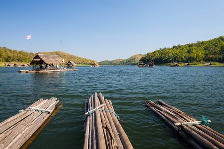 Bamboo raft floating on water in dam located at north east of Thailand