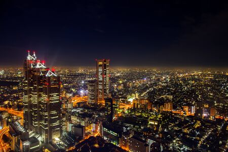 A colorful of cityscape night top view of Tokyo bay located at Japan