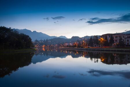 Night city landscape view with mountain background and cloudy sky reflection on water located at SAPA, Vietnam Stock fotó
