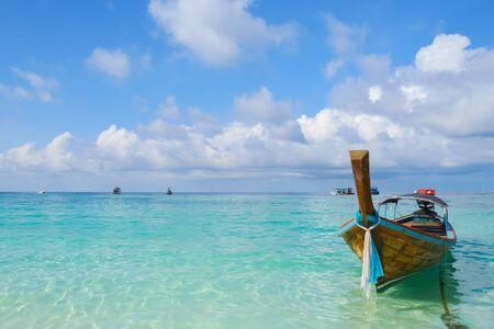 Long boat under clear sky