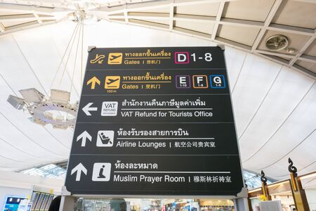 airport sign at gate with passenger