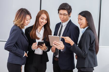 Young business people is standing concentrate on iPad and smile with white background