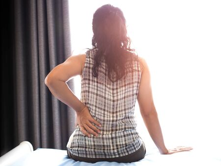 woman with back pain and waist pain Symptoms from muscle inflammation And hard work, office syndrome Stockfoto