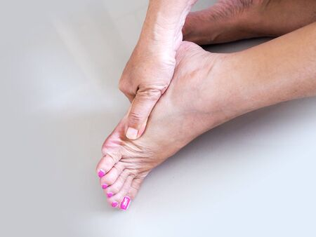 Foot injury of elderly Asian women, Heel pain from diseases plantar fasciitis or nerve inflamed.