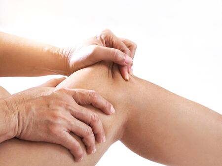 Close up hand of Asian women with knee and leg pain By using hands to massage body to relieve pain.