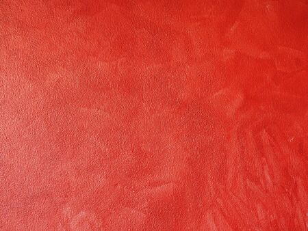 Abstract background with red cement wall.