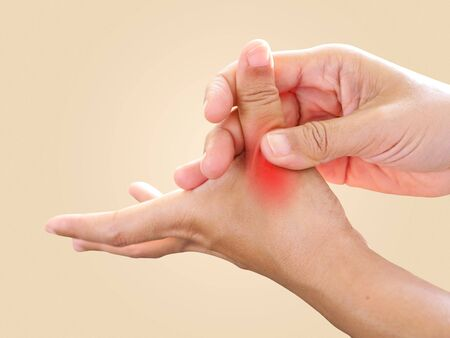 Hand pain and sore fingers, Thumb finger pain from work with nerve inflamed and trigger finger lock disease, Health care from illness concept. Standard-Bild