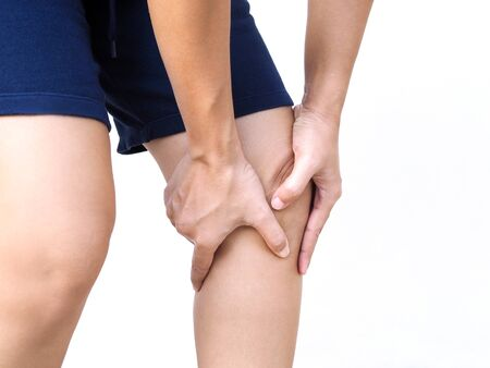 Asian people have knee pain, leg pain use hands touching on leg massage to relax muscle and relieve ache. Imagens