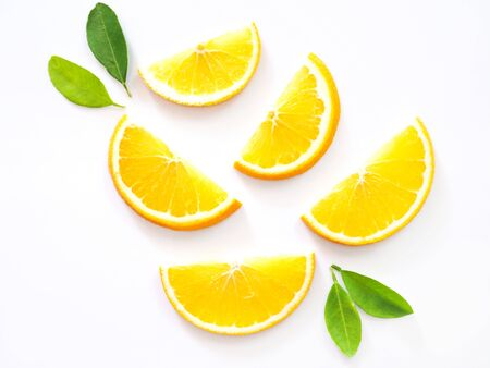 sliced of citrus oranges fruits with green leaves isolated on white background.