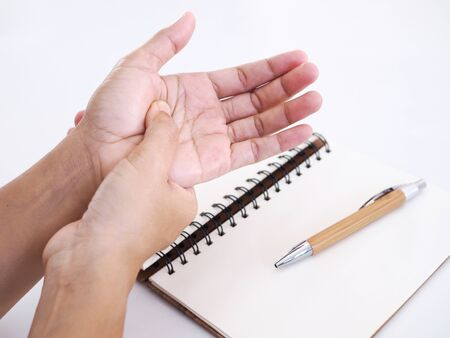 Close up of hand with hand pain, palms and nerve inflamed syndrome from office working. Stock Photo