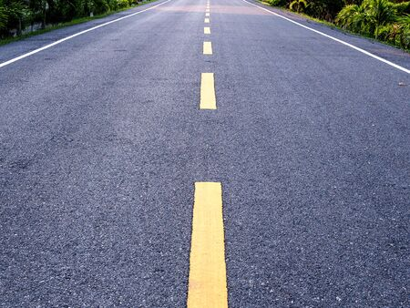Yellow line on asphalt road in Asia.