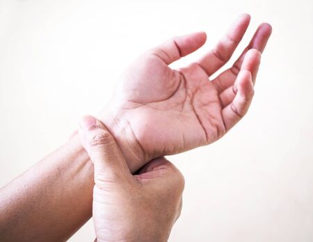Wrist injury pain, body and arms of young people, Inflamed wrist tendon Pain from work Office Syndrome.
