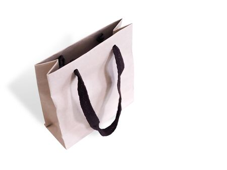 Packaging with brown paper bag handle from kraft paper isolated on white background Stock Photo